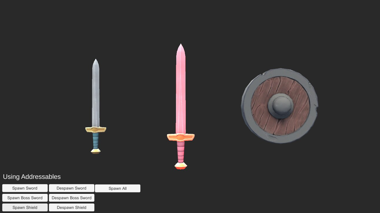 Left is a siver/grey sword, middle is a pink and gold/yellow sword, right is a wood/brown and silver/grey circular shield. 'Using addressables' is at the bottom right of the image with options such as 'spawn sword' and spawn shield' visible.
