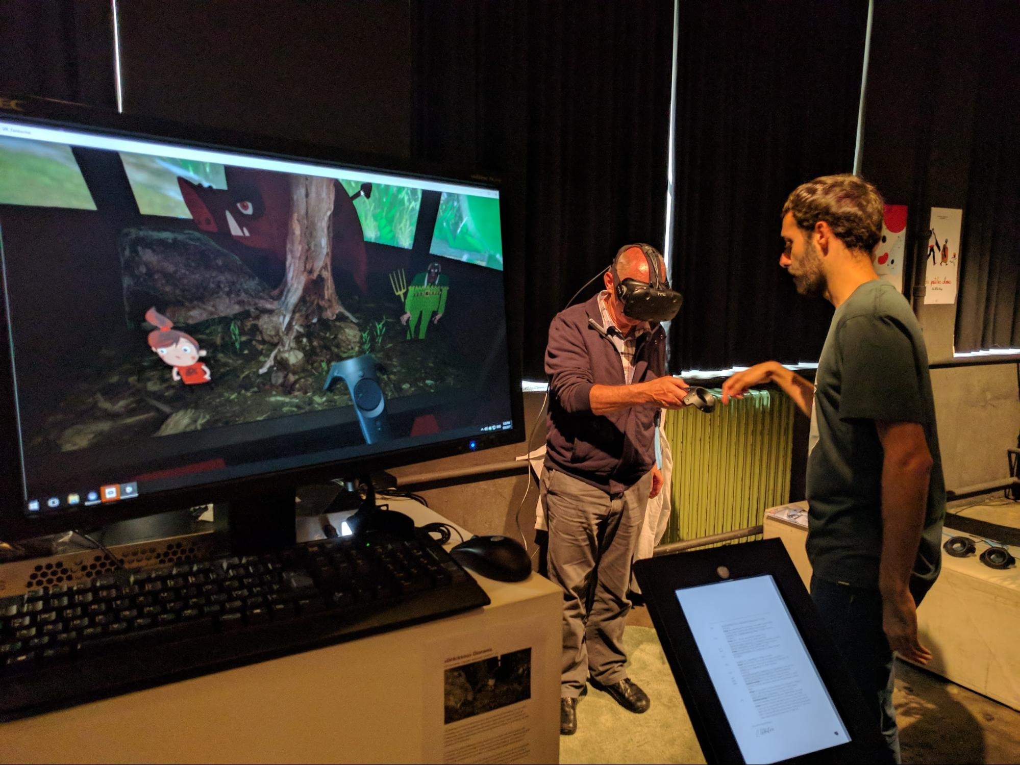 Photo - man using VR headset and others watching screen where he is playing