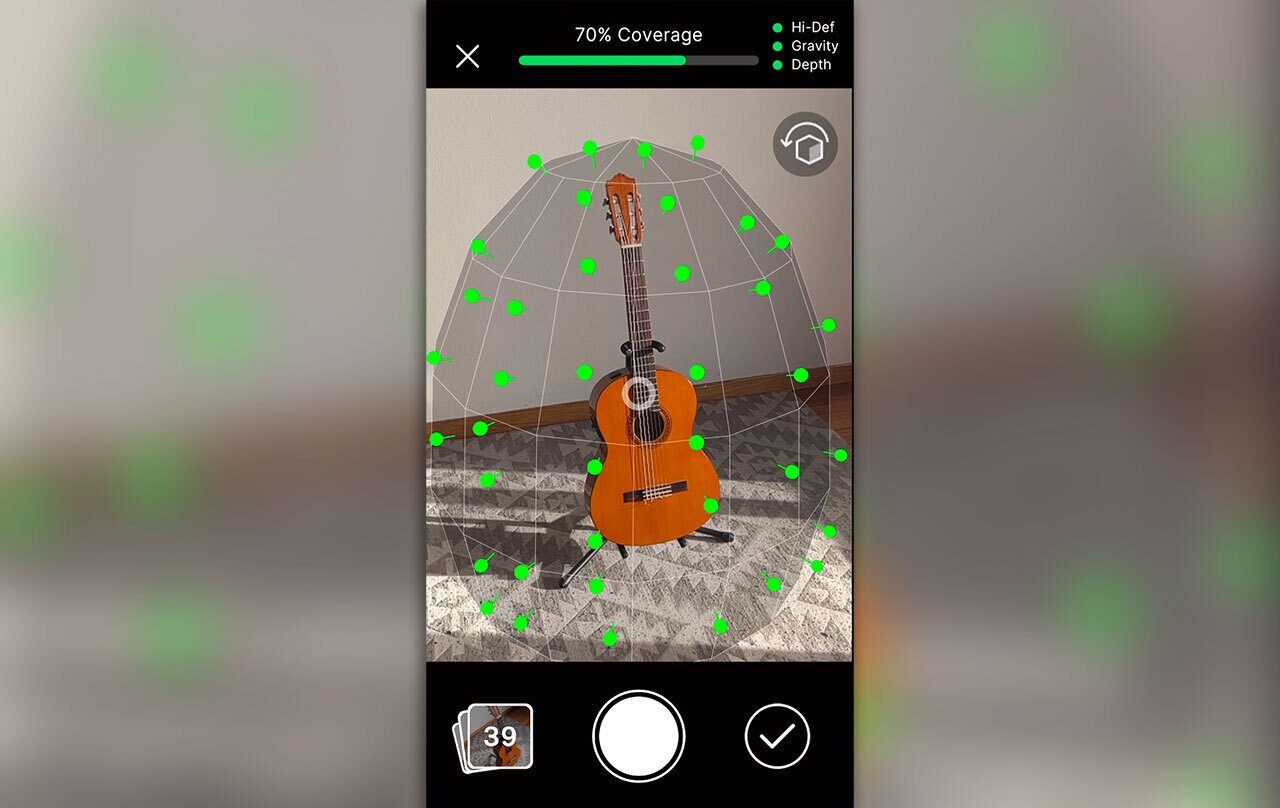 Image of phone screen grabbing image of guitar with all green pins