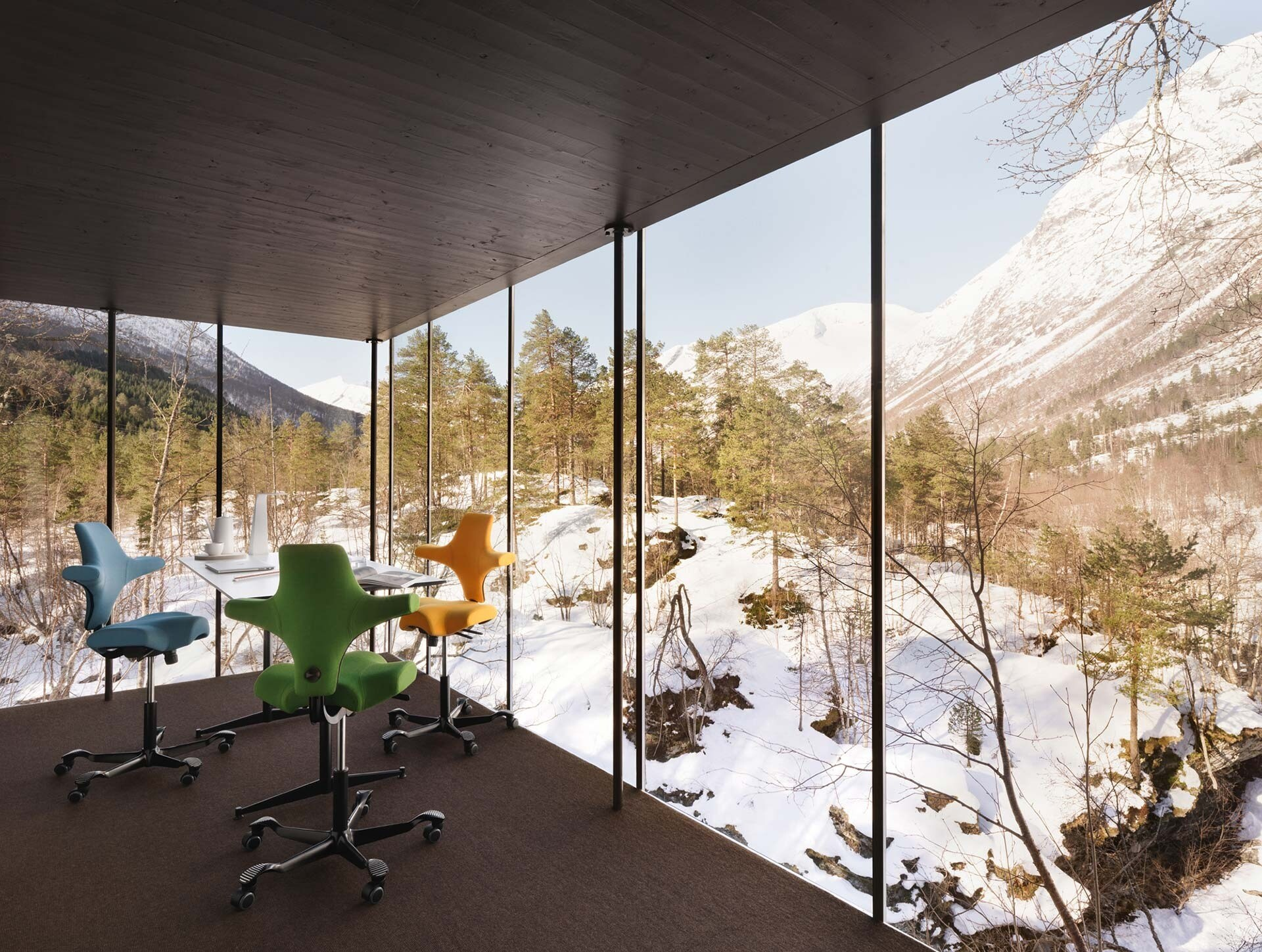 Simulation of Flokk chairs in a glass walled room looking out to mountains