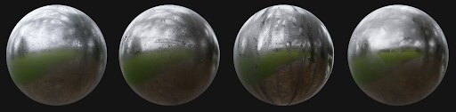 Four silver, reflective spheres sit alongside one another against a black background. The images they are reflecting is very blurry, but appears to be a park.