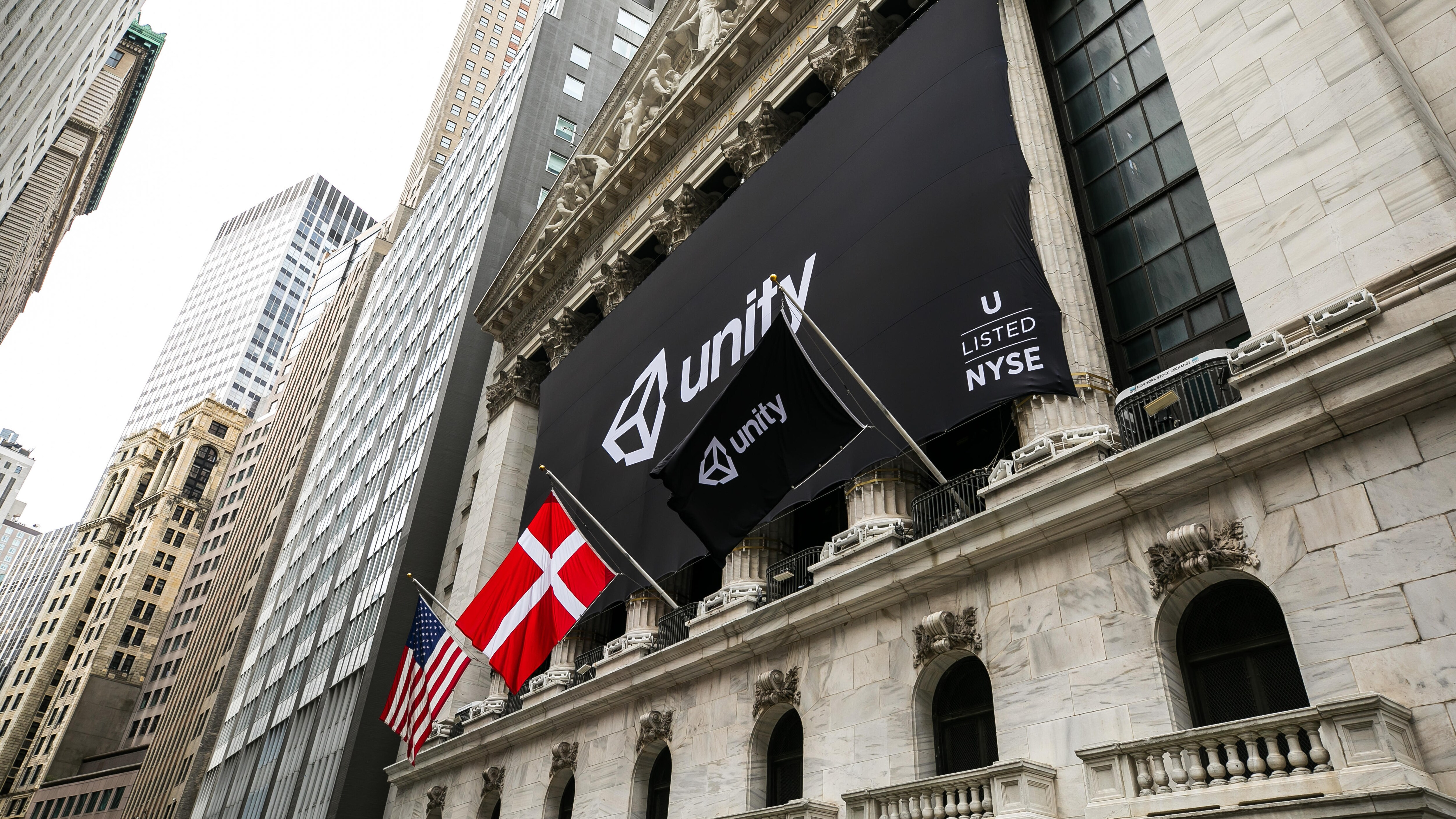 Unity banner and flags on the NYSE building