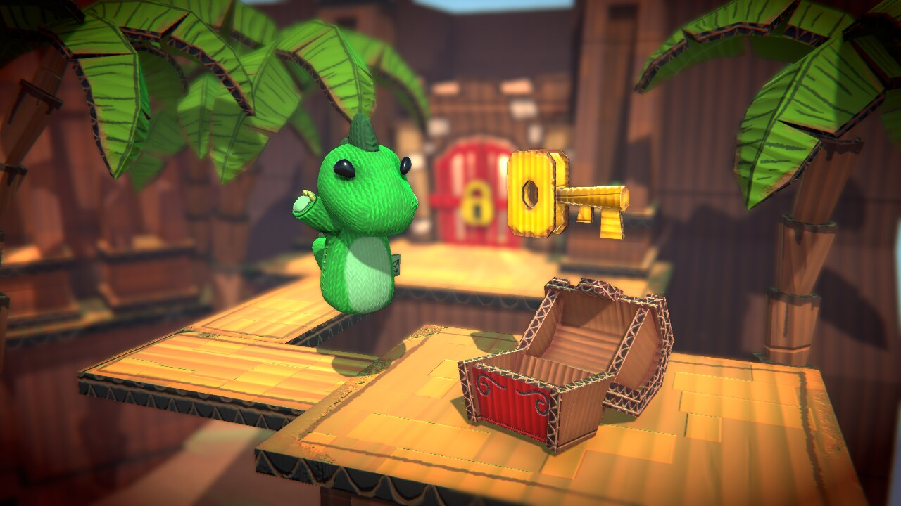 Cardboard dinosaur floating in the air in front of a cardboard pirate chest and key