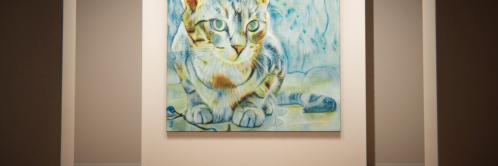 Cat looking at a cat painting
