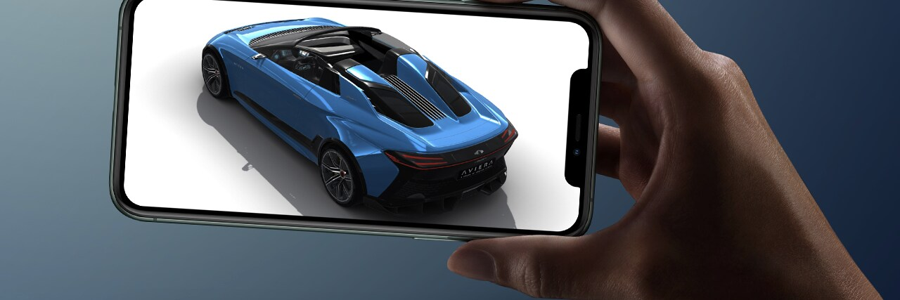 Hand holding smartphone showing a blue car